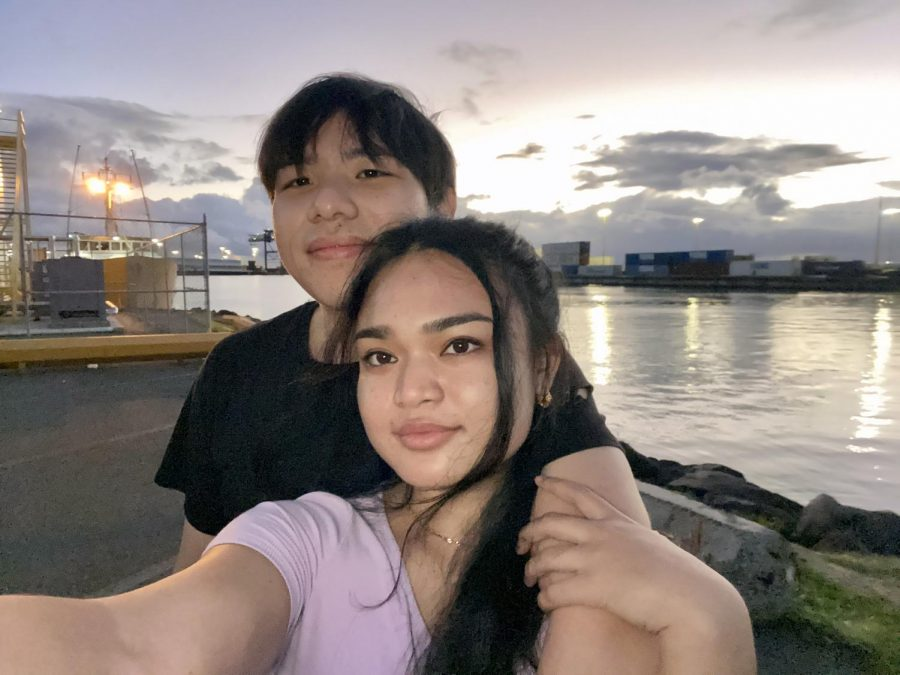Rianne Sanchez and Bailey Pan on a date watching the sunset from   the pier by Aloha Tower.