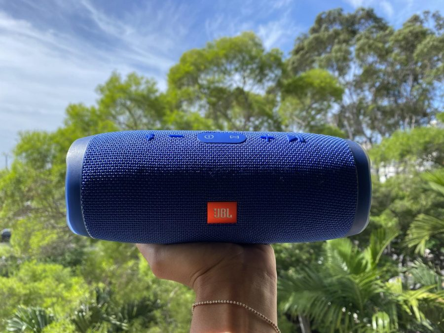 This is a picture of the JBL Flip Waterproof Portable Bluetooth Speaker. It is waterproof and will come in handy for indoor or outdoor activities of any kind.