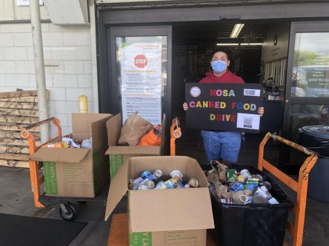 President of CUH HOSA Kelvin Manganaan delivers donated canned goods to Hawaii Food Bank.