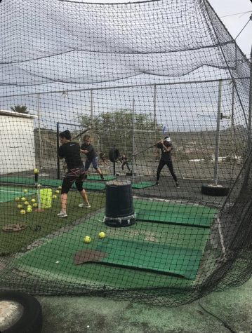 CUH softball team taking batting practice in preparation for the shortened spring season.